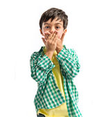 Kid covering his mouth over white background  — Foto de Stock