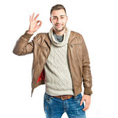 Man making an OK gesture over isolated white background  — Photo