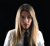 Young businesswoman over isolated black background  — Stock Photo
