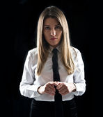 Young businesswoman over isolated black background  — 图库照片
