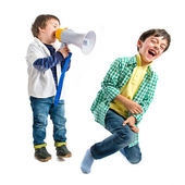 Kid shouting at his friend by megaphone over white background  — Stock Photo