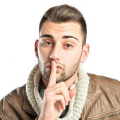 Young man making silence gesture over isolated white background  — Stock Photo