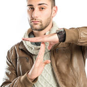 Handsome man doing the timeout sign over white background  — Stock Photo