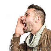 Young man screaming over isolated white background  — Stock Photo