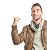 Young man winner over isolated white background  — Stock Photo