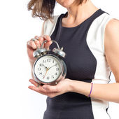 Pretty woman holding an antique clock over white background  — Stockfoto