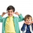 Boys covering his ears over white background. — Stock Photo #46819965