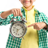 Boy holding an antique clock over white background  — 图库照片