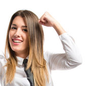 Young businesswoman winning over white background  — Stock Photo