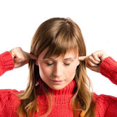 Young pretty woman covering her ears over white background  — Stok fotoğraf