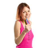Young redhead girl holding crayons over white background — Stock Photo