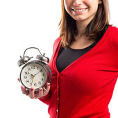 Happy young Girl holding an antique clock over white background — Stock Photo