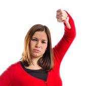 Young girl doing a bad signal over white background — Stock Photo