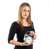 Young Girl holding an antique clock over white background  — 图库照片