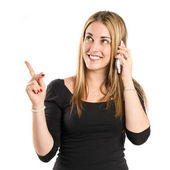 Young girl talking on mobile over white background  — Stock Photo
