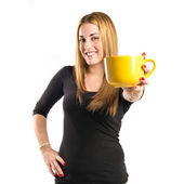 Pretty girl holding a cup of coffee over white background  — ストック写真
