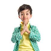 Brunette boy pleading over isolated white background  — Stock Photo