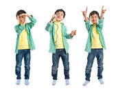 Kid singing, doing time-out gesture and making horn sign — Stockfoto