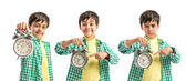 Boy holding an antique clock over white background  — Stock Photo