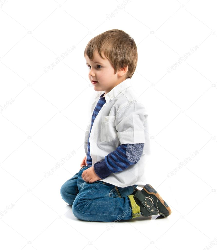 blonde kid sitting on floor over white background stock photo luismolinero 46828383. Black Bedroom Furniture Sets. Home Design Ideas