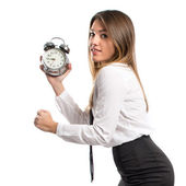 Young businesswoman holding an antique clock over white background  — Stock Photo
