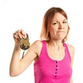 Redhead girl holding vintage padlock over white background  — Stock Photo