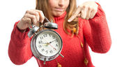 Young girl pointing an antique clock over white background  — Stock Photo