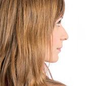 Jonge mooie blonde meisje op witte achtergrond — Stockfoto
