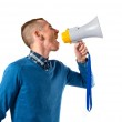 Redhead man shouting by megaphone over white background — Stock Photo