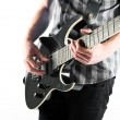 Young man playing guitar over white background — Stock Photo #47885557