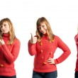 Young woman making Ok sign and pointing — Stock Photo #47887617