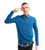 Man making a crazy gesture over white background — Stock Photo