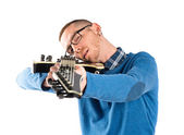 Young man with his guitar over white background  — Photo