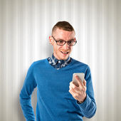 Young man shouting to mobile over grey background. — Stock Photo