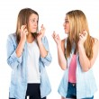 Girls with her fingers crossing over white background — Stock Photo #49313637