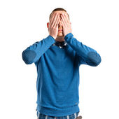 Men covering his eyes over white background  — Stock Photo