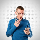 Men with phone surprised over grey background  — Stockfoto