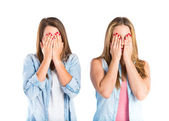 Girls covering her eyes over isolated white background  — Stock Photo