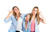 Girls making suicide gesture over white background  — Stock Photo