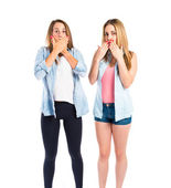 Girls doing surprise gesture over white background — Foto de Stock