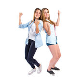 Lucky girls  over isolated white background — Stock Photo