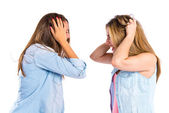 Frustrated girls over isolated white background  — Stock Photo