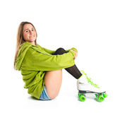 Pretty young girl wearing urban style with roller-skates — Foto Stock