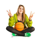 Pretty young girl wearing urban style with basketball — Foto Stock