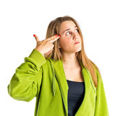 Girl making suicide gesture over white background  — Stock Photo