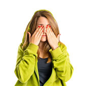 Young girl covering her eyes over isolated white background  — Stock Photo