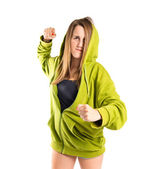 Young girl giving punch over isolated white background  — Stock Photo