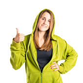Pretty young girl with thumbs up over white background  — Stock Photo