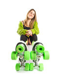 Blonde girl with rollerblade over white background — Stock Photo