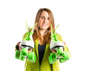Girl with rollerblade over white background — Stock Photo